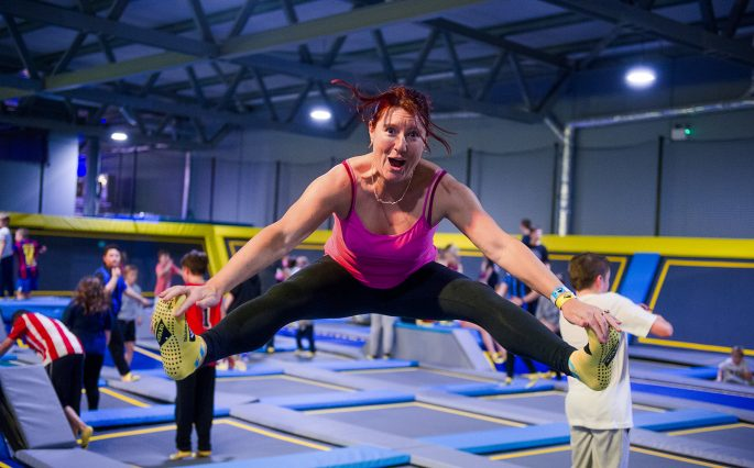 Woman trampolining smiling