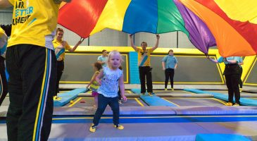 Toddlers at party in trampoline park