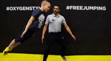 boy learns from an instructor at the Oxygen School of Trampolining