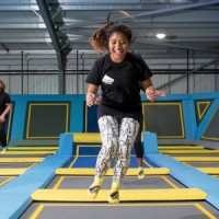 Fitness airborne close up jump smiling