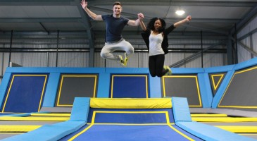 loving couple jump into the air at Oxygen Freejumping