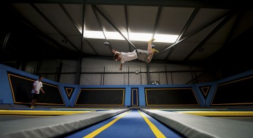 Boy does pic jump over trampolines