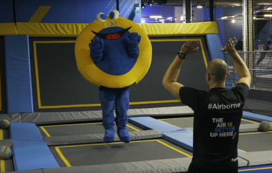 Mascot jumps on trampoline