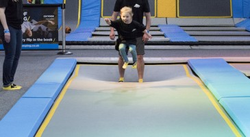 Toddler tumbling on long trampoline
