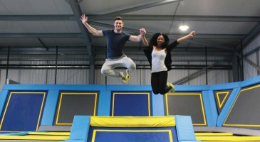 Two friends jump in trampoline park