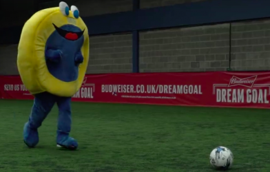 oxygen freejumping mascot playing football