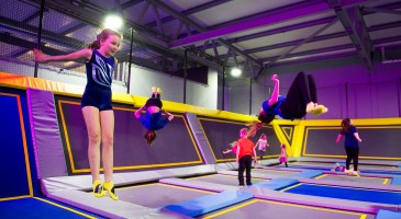 Kids jumping on trampoline in world record attempt