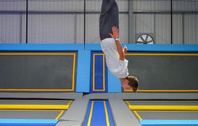 Epic somersault from boy on trampolines