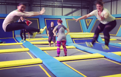 Two women jumping on trampolines in Airborne Fitness class
