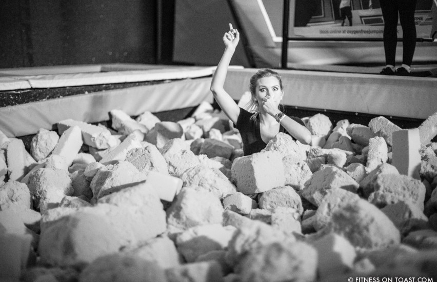 Fitness blog girl having fun in obstacle course