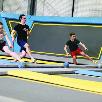 Group playing trampoline dodgeball