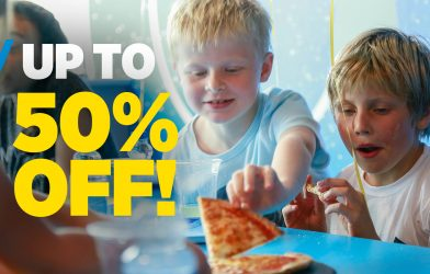 Kids reaching for pizza in trampoline park party