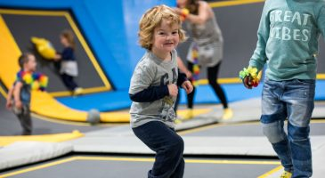 Little boy smiling in safe and clean trampoline park