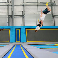 2 people jumping in trampoline park